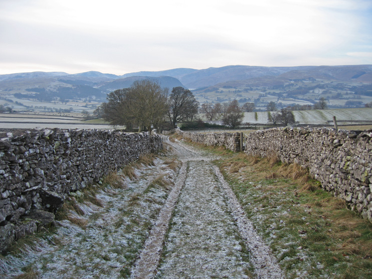 Looking back down the lane above Scarside with the Haweswater fells in the distance