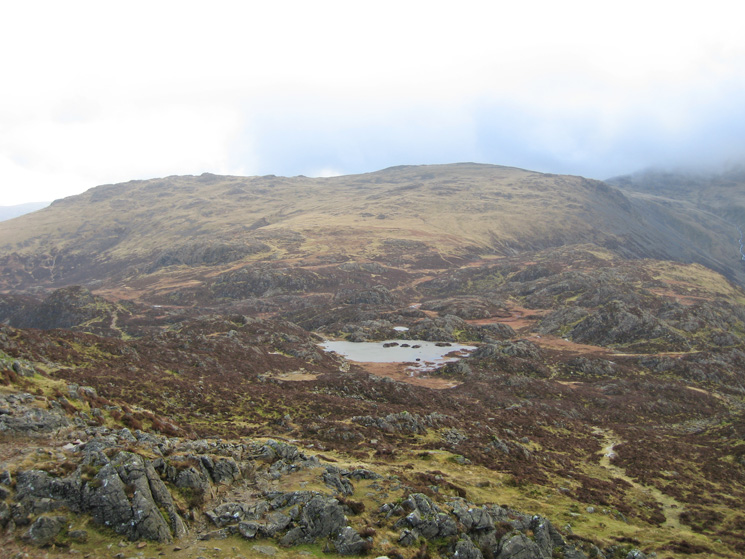 Innominate Tarn with Grey Knotts and Brandreth beyond from Haystacks