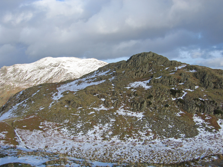 Arnison Crag with a snowy Place Fell behind