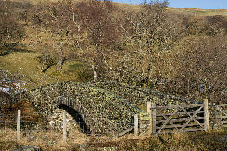 The new 'packhorse' bridge across Sleddale Beck. Erected by Manchester Corporation so not so new now!
