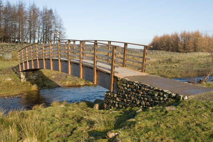 The new footbridge across the outflow of Wet Sleddale Reservoir which becomes the River Lowther