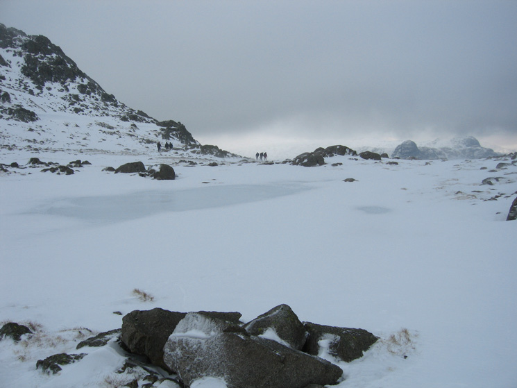 One of the Three Tarns, frozen, and the top of Pike O'Stickle on the right