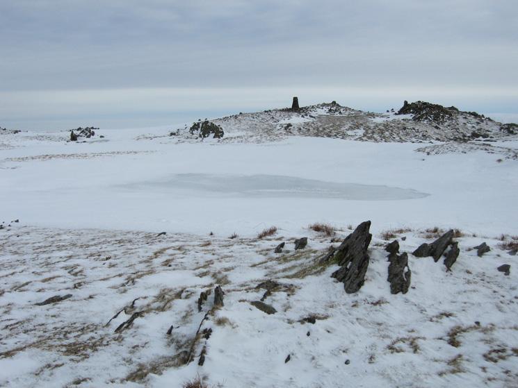 Red Screes frozen summit tarn