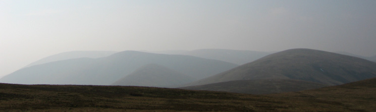 South to hazy Howgills. Randygill Top on the right from Green Bell's summit
