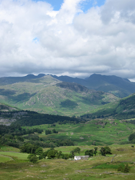 Pike o'Blisco with Crinkle Crags and Bowfell beyond. Low Arnside at the bottom of the photo