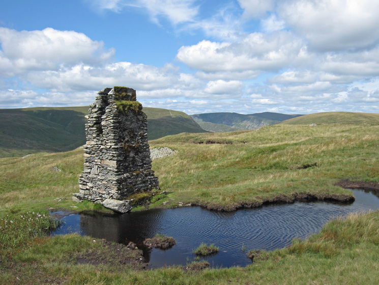 The survey pillar near Tarn Crag's summit cairn