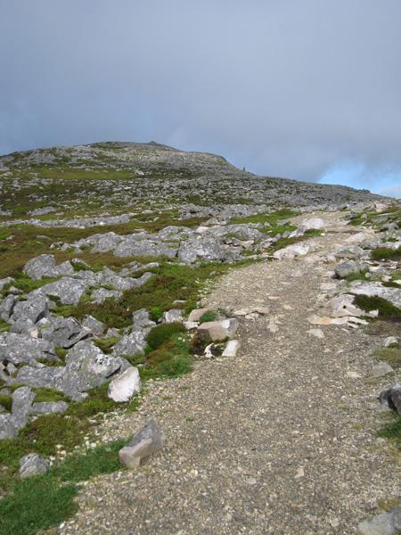 On the ridge with false summit ahead