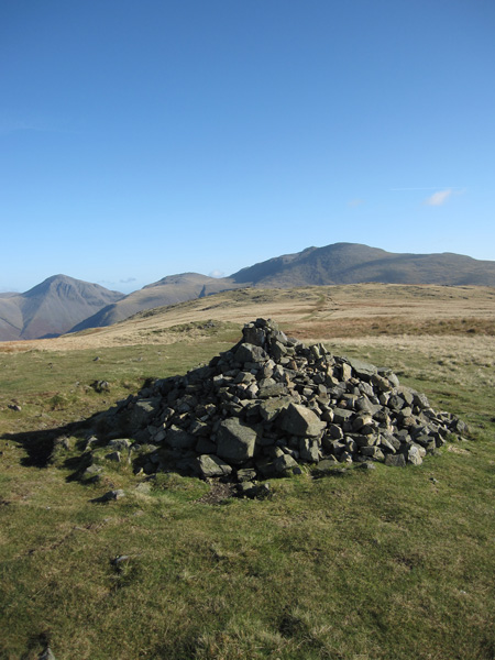 Illgill Head's main summit cairn at 604m, the ground ahead is slightly higher with a  609m spot height