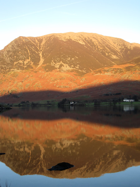 A golden Grasmoor reflecting in Crummock Water