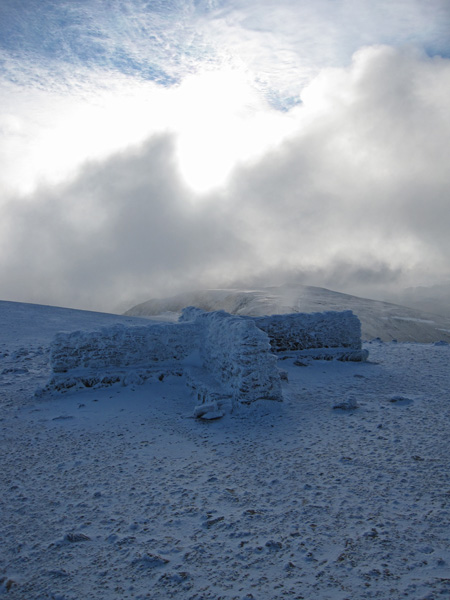 Looking south into the sun from next to Helvellyn's summit shelter