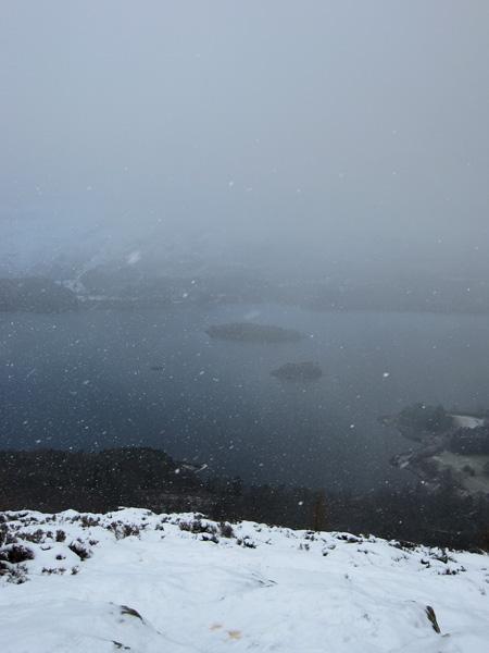 Heavy snow shower on Walla Crag's summit