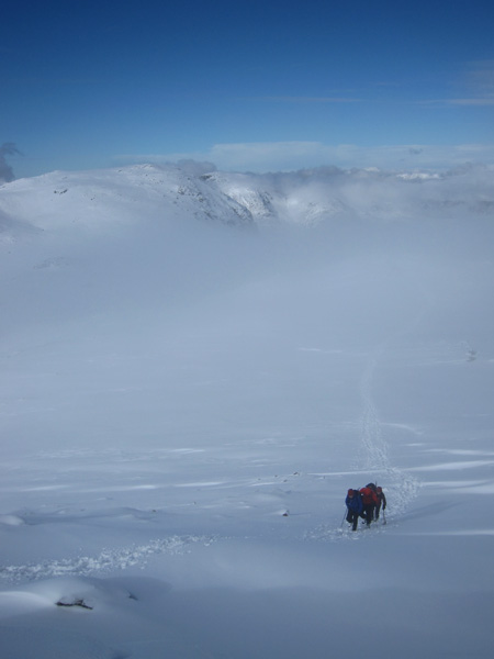 Walkers approaching Esk Pike's summit from Esk Hause