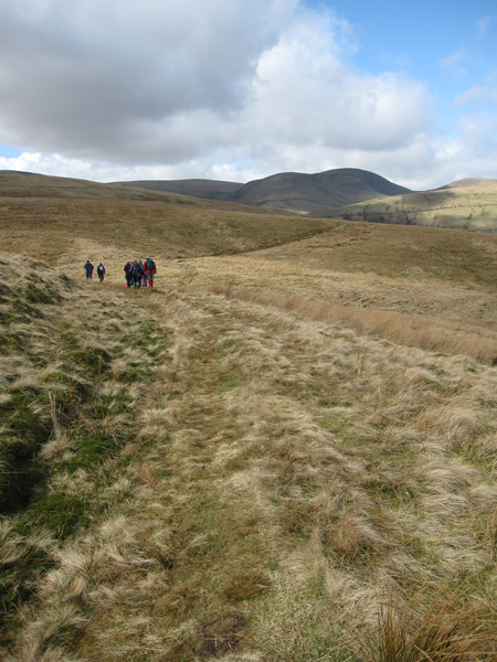 A group of walkers heading the other way with Yarlside in the distance