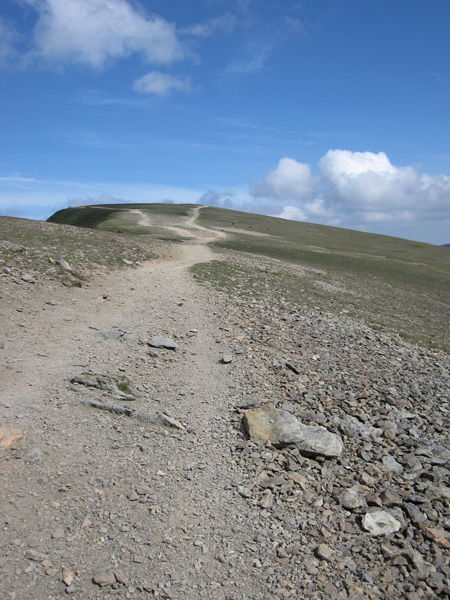Towards the flat top of Helvellyn, the path on the right goes straight to the trig point