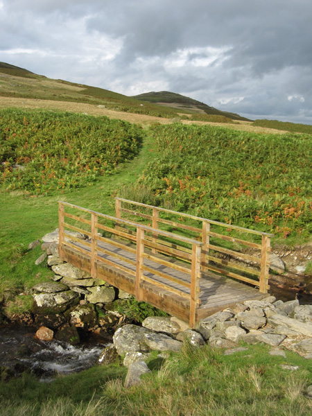 Looking back to Four Stones Hill from the footbridge across Measand Beck