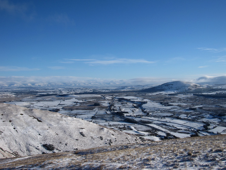 The North Pennines in the distance, Great Mell Fell on the right and the A66 centre