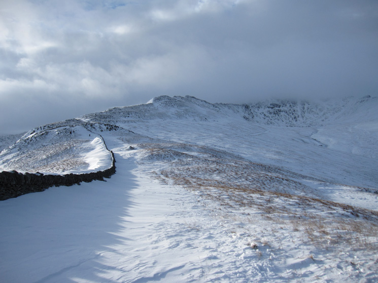 Striding Edge and Helvellyn in cloud from the route to Birkhouse Moor