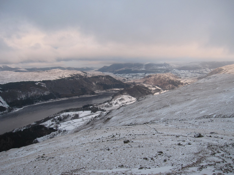 A frozen Thirlmere below and the top of the Skiddaw fells in cloud