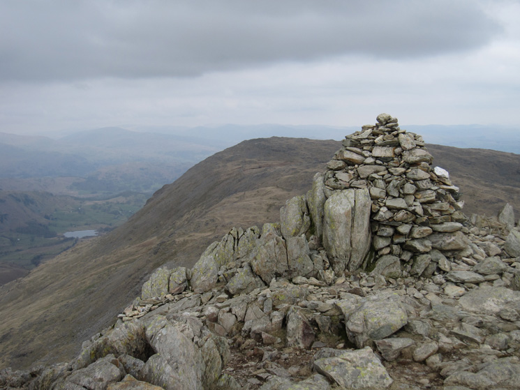 Swirl How summit with Wetherlam behind and Little Langdale Tarn far below