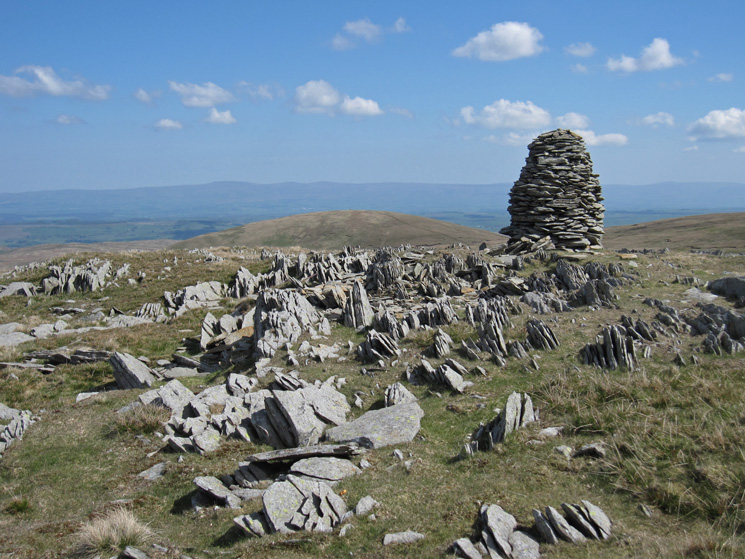 Selside Pike with the North Pennines beyond from the higher of the two cairns on Artle Crag