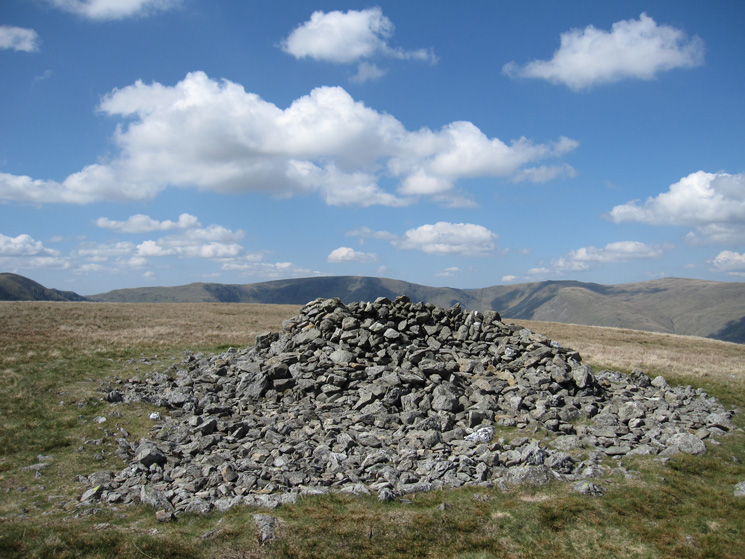 Selside Pike's summit cairn/shelter with High Street in the distance