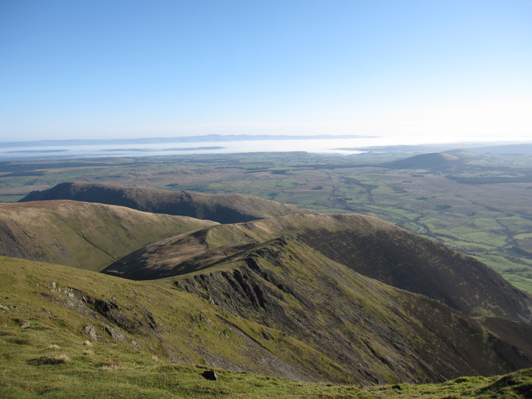Scales Fell with the North Pennines in the distance and the Eden Valley under cloud