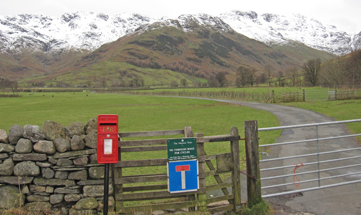 The Band with Bowfell on the right and Crinkle Crags on the left from the start of the road to Stool End Farm