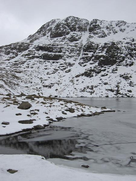 Looking across a partly frozen Angle Tarn to Hanging Knotts