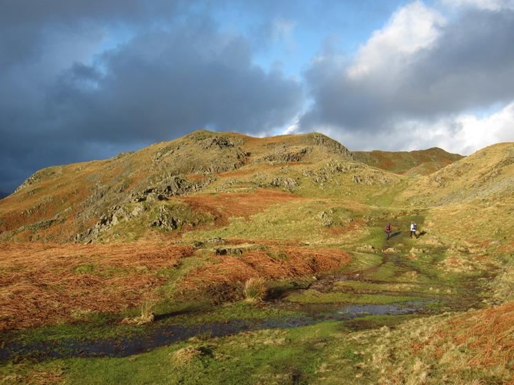 A burst of sunlight, looking back towards the summit