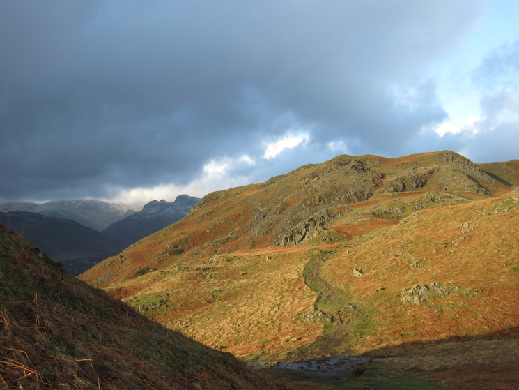 A glimpse of the Langdale Pikes