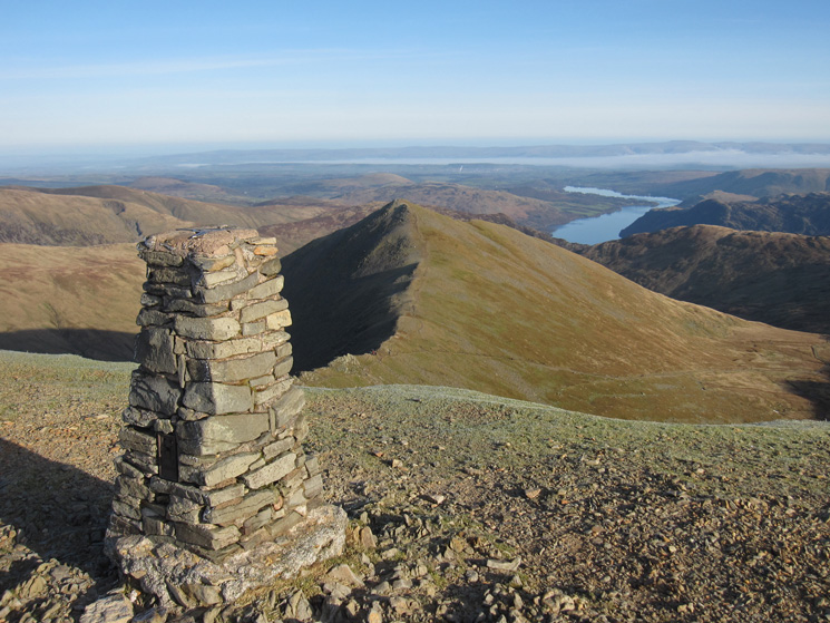 Helvellyn's summit trig point, Catstycam and Ullswater