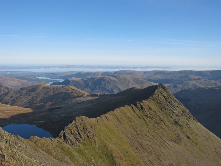 Striding Edge and part of Red Tarn, there is a cloud inversion in the Eden Valley, the North Pennines in the far distance