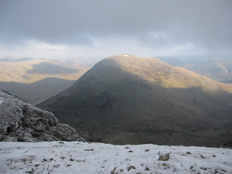 A brief parting of the clouds reveals Saint Sunday Crag