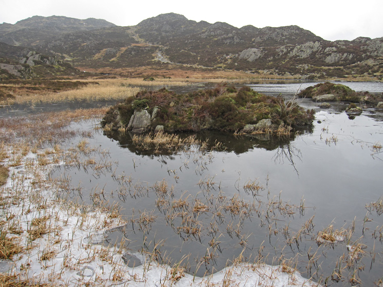 Looking back to Haystacks from a partly frozen Innominate Tarn
