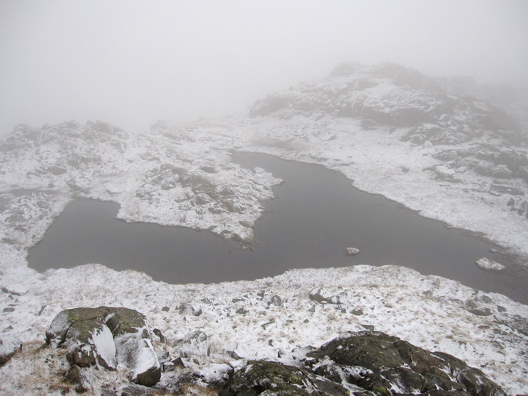 This U shapped tarn is a great reference point to confirm you are at the top, and its on the OS 1:25,000 map