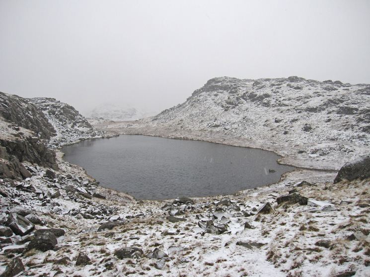 An unnamed tarn and Seathwaite Fell's southern top