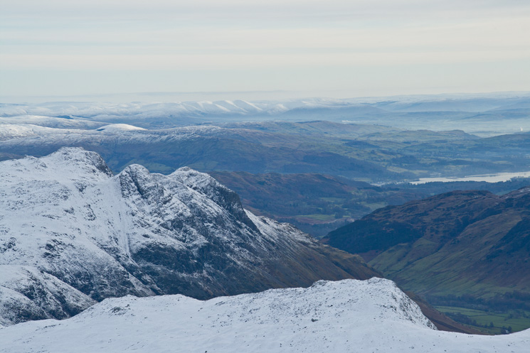 The Langdale Pikes with the Howgills in the far distance from Great End's summit