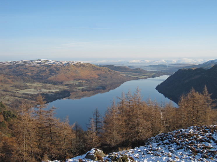 Gowbarrow Fell and Ullswater with the snowy North Pennines in the far distance from Glenridding Dodd's summit