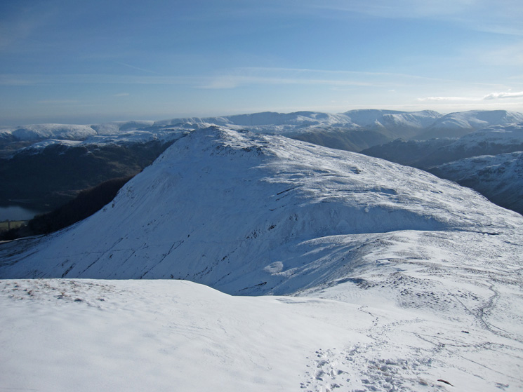 Looking back to Sheffield Pike with the Far Eastern fells behind
