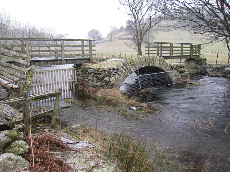Old packhorse bridge across St John's Beck