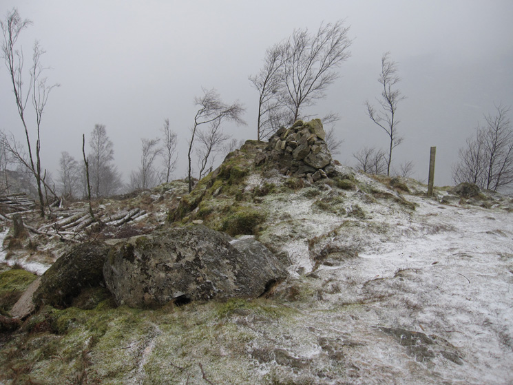 Great How's old summit cairn. Tree felling now allows access to the true summit
