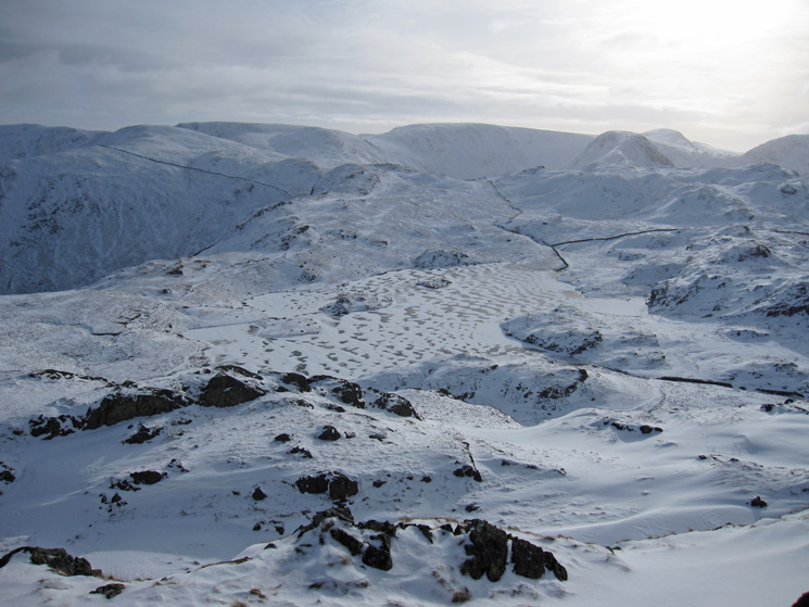 Over a frozen Angle Tarn to High Street in the distance from Angletarn Pikes' southern top