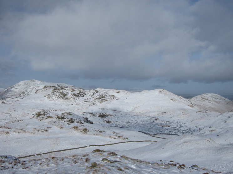 Angle Tarn with its pikes behind from Brock Crags. Place Fell behind again on the far left. Beda Head on the far right.