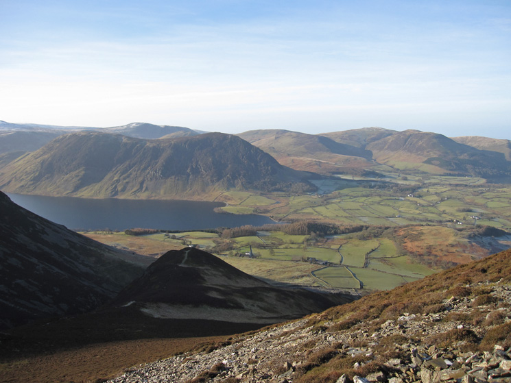 Above Whin Ben and in the sun. Mellbreak on the far side of Crummock Water