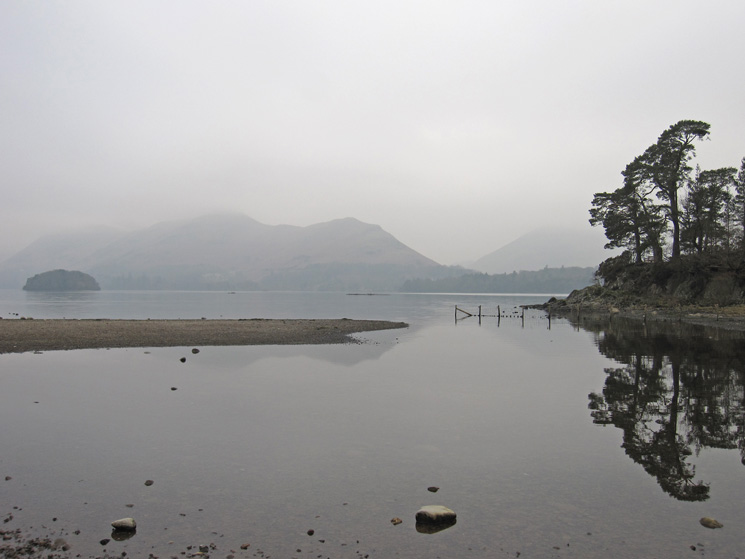 Friar's Crag with Catbells on the far side of Derwent Water. The water level is low.