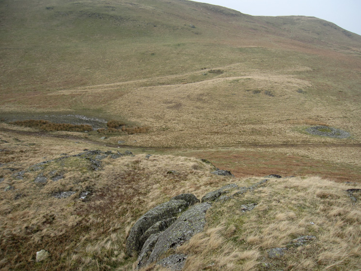 The dried up tarn and prehistoric round cairn from Four Stones Hill