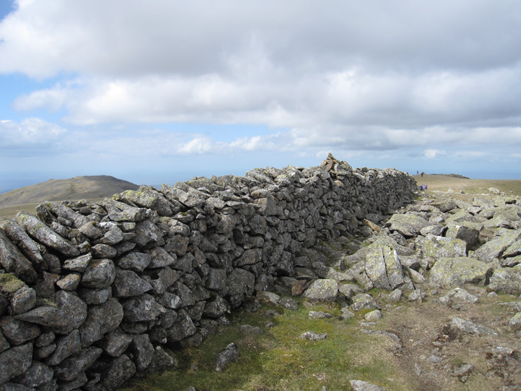 Scoat Fell's summit cairn on the wall