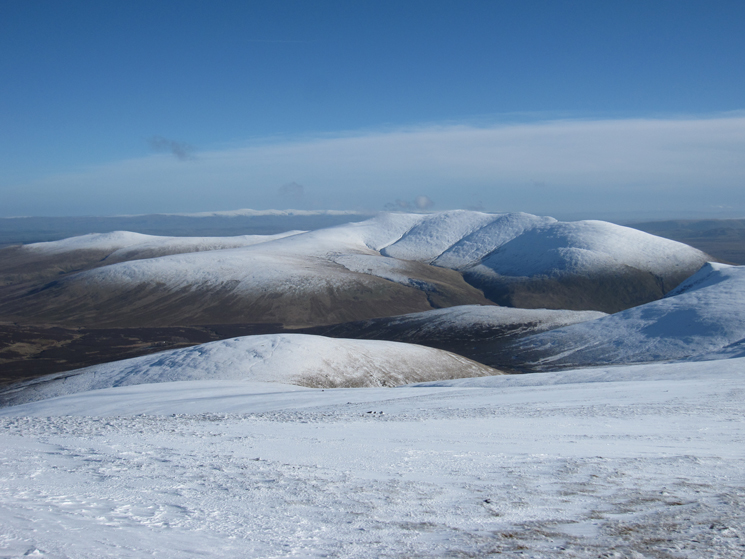 The back of Blencathra and the snowy North Pennines in the far distance