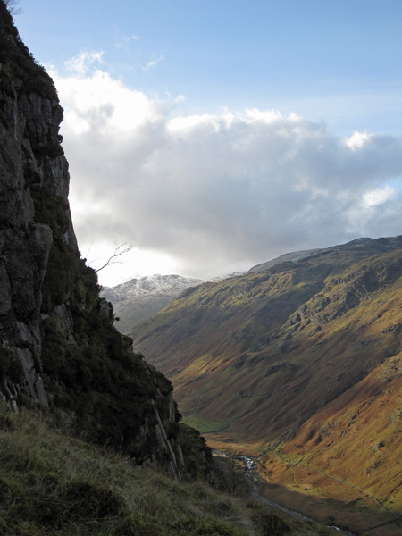 The flanks of Glaramara on the far side of Langstrath and a touch of snow on Esk Pike in the distance