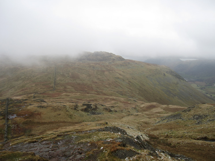 Looking back to Little Hart Crag, almost cloud free, as we ascend Red Screes